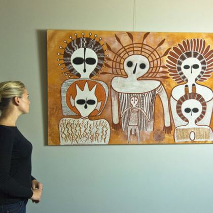 Tourist enjoying Wandjina artworks by Donny Woolagoodja (left) and Pudja Barunga at the Mowanjum Art and Culture Centre, located in Derby